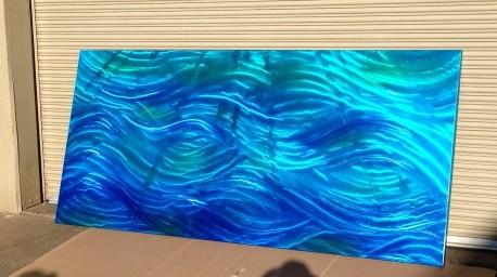 metal art with blue spectre pealrl