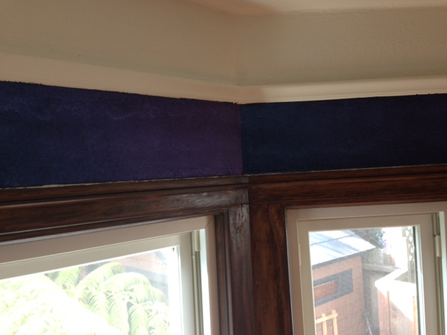 Bay window showing difference in colors on chameleon faux finish wall.
